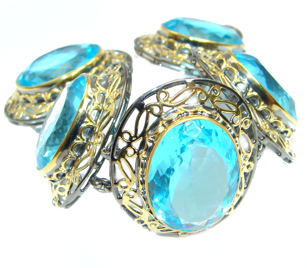 Giant Blue Ocean simulated Blue Topaz Gold Rhodium plated over Sterling Silver handcrafted Bracelet
