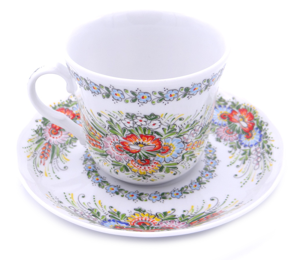 Entirely Hand painted Porcelain Cup and Saucer decorated on the inside 114016
