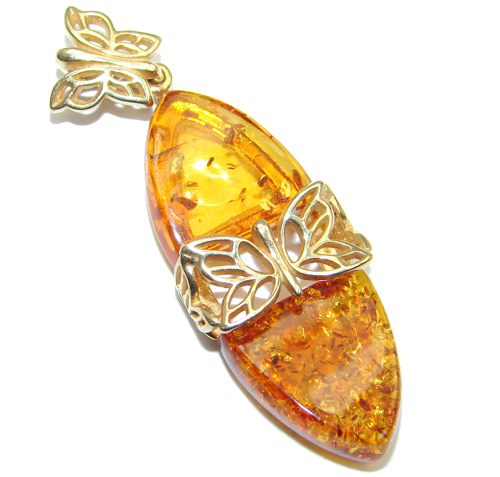 Incredible natural Baltic Amber Rose Gold plated with Sterling Silver handma..