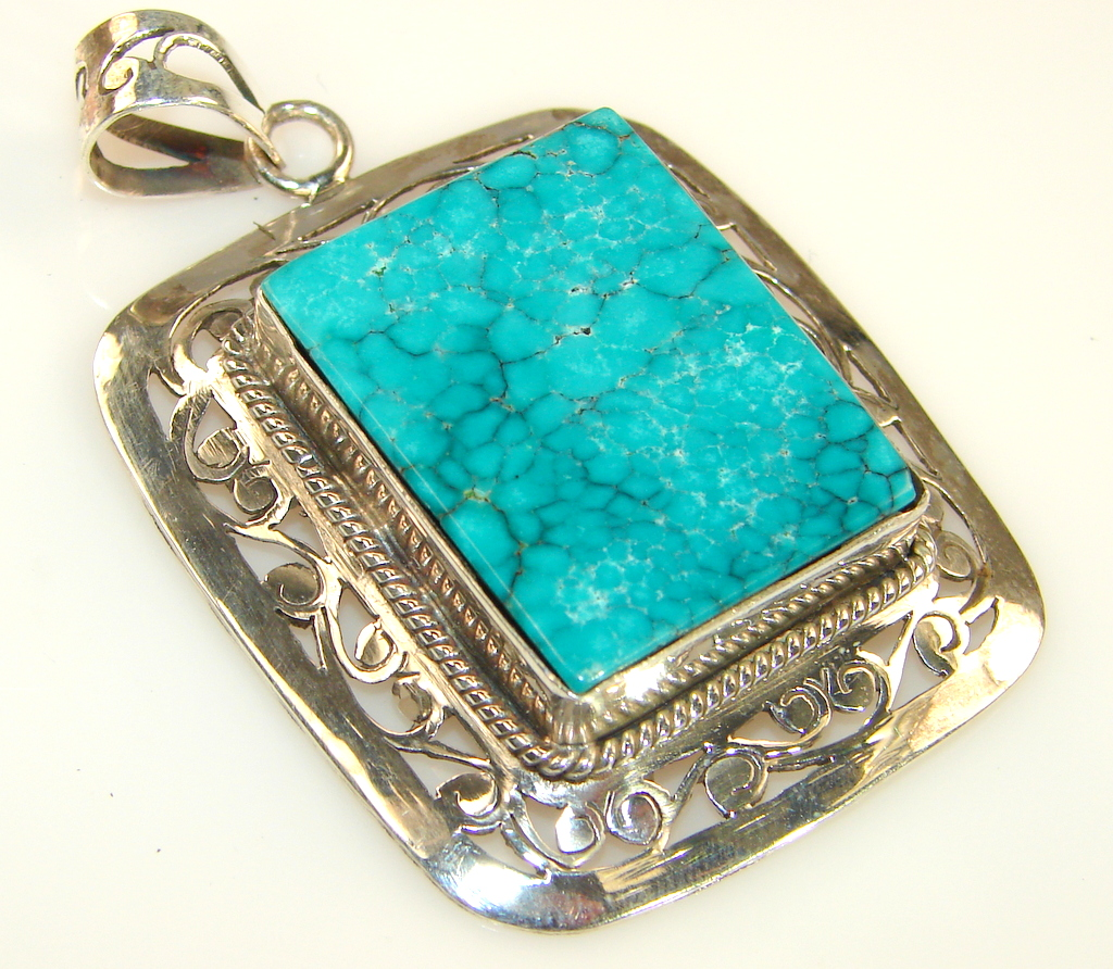 Artisan Design Of Blue Turquoise Sterling Silver pendant