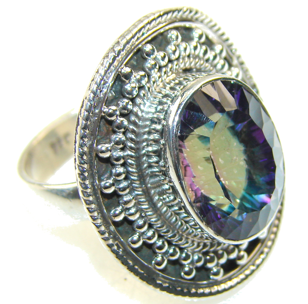 Amazing Color Of Magic Topaz Sterling Silver ring; s. 9