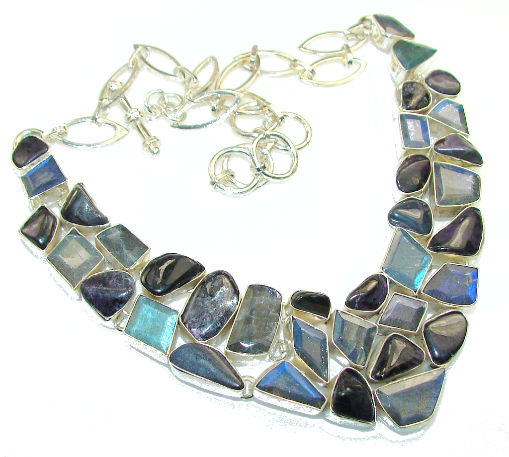 Handmade Artisan Sterling Silver 925 Necklace with unique one of a kind Labradorite,  77.50 grams of marvelous handcrafted jewelry design. Only one piece availble ready to ship! It's unique worldwide necklace - simply piece of art in world of fine jewelry. Love Declared! Fire Labradorite Sterling  Silver necklace  NECKLACE DETAILS: Weight: 77.50g; Material: Sterling Silver; Main stone: Labradorite; Other stones: Amethyst; Inner circumference: 16 inch; Drop Part: 1 3/8 inch; Clasp: toggle; Stamp / Mark: 925; Condition: New; Main color: blue; Shape: Multi-shape; Collection: Agra;  Item Code: 14-sty-15-2