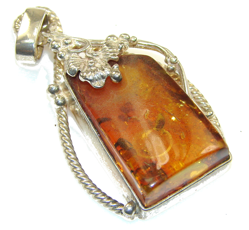 Classy Brown Polish Amber Sterling Silver Pendant